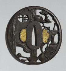 Tsuba z dekoracją wyobrażającą przybory do