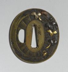 Tsuba z motywem koła dworskiej karety