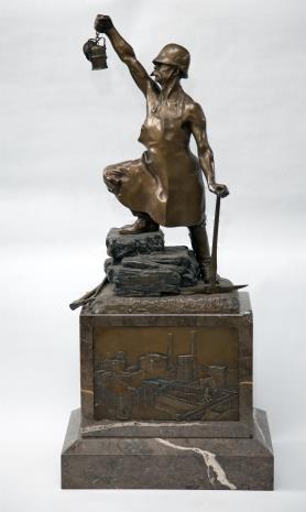 Bracia Łopieńscy , Statuetka górnik