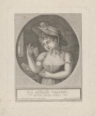 Dziewczynka trzymająca kiście winogron w rękach