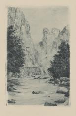 Krajobraz z rzeką płynącą u podnóża skał