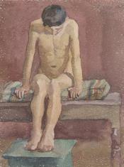 Siedzący chłopiec