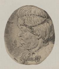 Głowa mężczyzny w białym zawoju z perłami