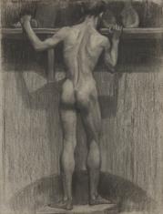 Akt stojącego tyłem mężczyzny